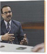 Businessman explaining idea in office meeting Wood Print