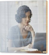 Businesswoman using laptop in office Wood Print