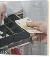 Cash In Hand Of Customer Paying In Supermarket Wood Print