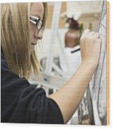 Caucasian girl painting Wood Print