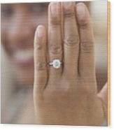 Close up of hand with engagement ring Wood Print