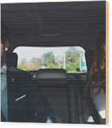 Couple on a wedding day, inside the car Wood Print