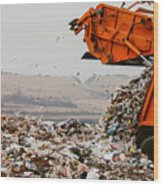 Garbage truck dumping the garbage Wood Print