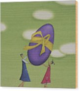 Girls Holding a Large Easter Egg Wood Print