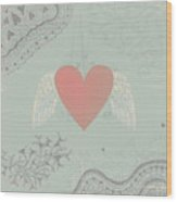 Heart with wings on seamless doodle background Wood Print