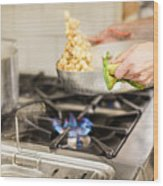 Midsection Of Chef Keeping Utensil On Stove In Kitchen Wood Print