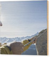 Mountaineer pulls rope tight to teammate, mtns Wood Print