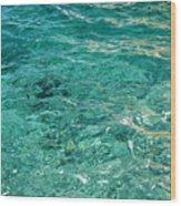 Reflection on blue sea Wood Print