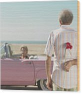 Senior man surprising wife with flower Wood Print