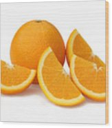Sliced orange quarters and whole orange. Wood Print