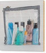 Travel Toiletries in Clear Plastic Bag Wood Print
