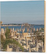 Umbrellas and beach chairs on the beach, Cannes, French Riviera Wood Print