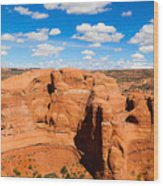 View Of Rock Formations Against Cloudy Sky Wood Print