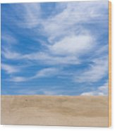 View Of Sand Against Blue Sky And Clouds Wood Print