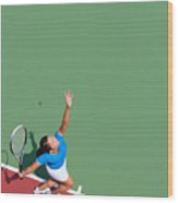 Young tennis player serving Wood Print