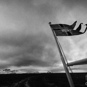 8ad4f0f70dc8e9 Norwegian Post Postal Flag On A Ship Carrying Mail On A Cold Overcast Day  At Sea Norway Europe Photograph by Joe Fox