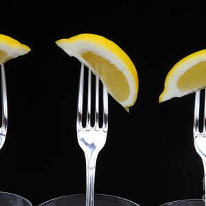 728920427fbe Three Forks With Three Lemon Wedges On Black by Rosemary Calvert