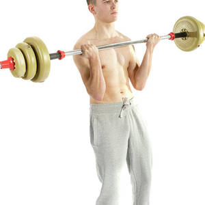 18 Year Old Teenage Boy Lifting Weights Photograph by Ben
