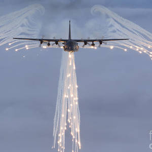 a c 130 hercules releases flares photograph by high g productions