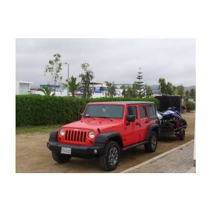 front and side view of a mint condition red color jeep wrangler rubicon  with 4 0 l