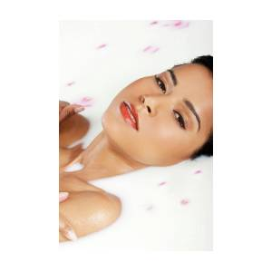 Attractive Naked Woman Lying In A Milk Bath. With Rose