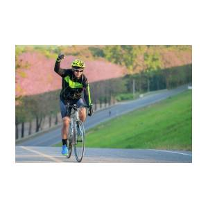 Asian Man Ride A Bicycle On The Road With Nature Background