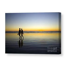 789bea001f0 Young Couple Walking On Romantic Beach At Sunset Canvas Print   Canvas Art  by Colin and