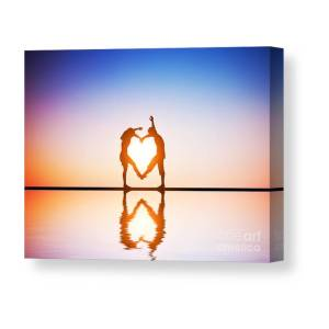 965f59139d8 A Happy Couple In Love Making A Heart Shape With Their Bodies At Sunset  Canvas Print