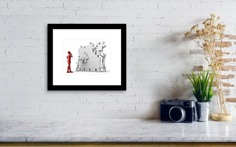 Men Putting Puzzle Pieces Together Framed Print by Pasieka