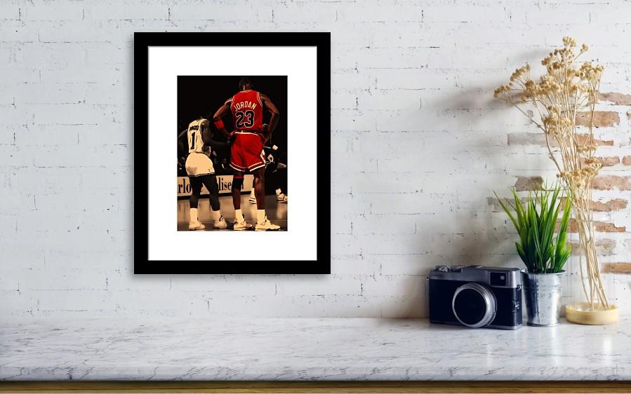 Michael Jordan Framed Print featuring the digital art Air Jordan And Muggsy  Bogues by Brian Reaves. Wall View 001 93593e192