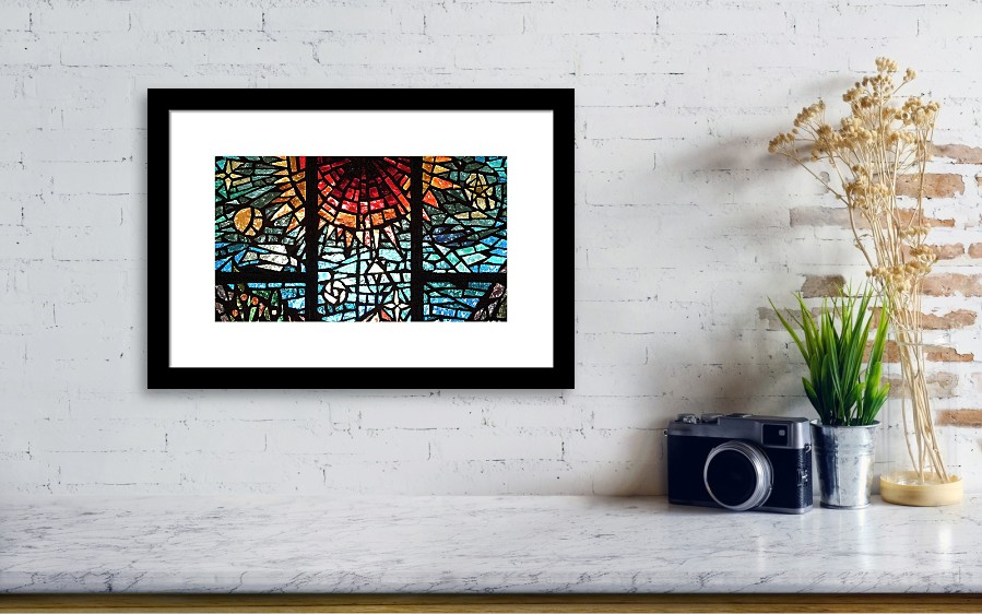 Stained Glass Sun Framed Print by Michael Flood